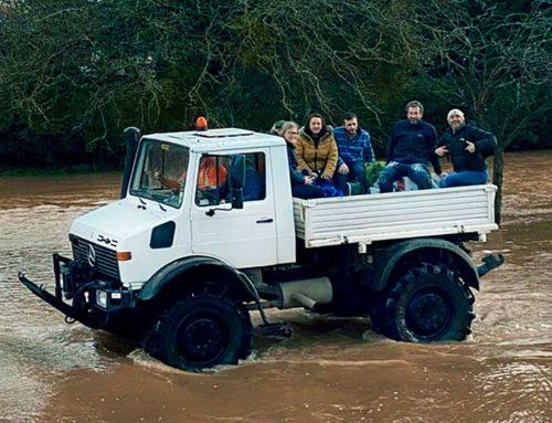 An apple farmer and his Unimog braving the floods.